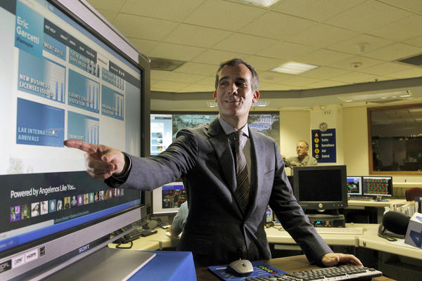"Los Angeles Mayor Eric Garcetti, marks his 100th day in office with a sneak peek of his city government ""performance metric"" beta website, which will be used to measure the progress and performance of city departments, during a news conference inside the Automated Traffic Surveillance and Control Center in Los Angeles."