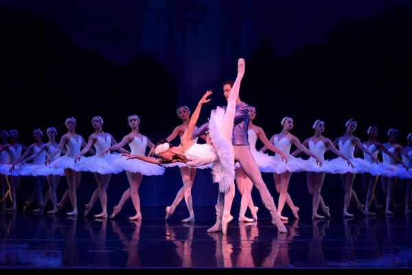 "Areum Chung and David Kiyak (foreground) are at the center of the ""Swan Lake"" segment in Orlando Ballet's ""Tribute."""