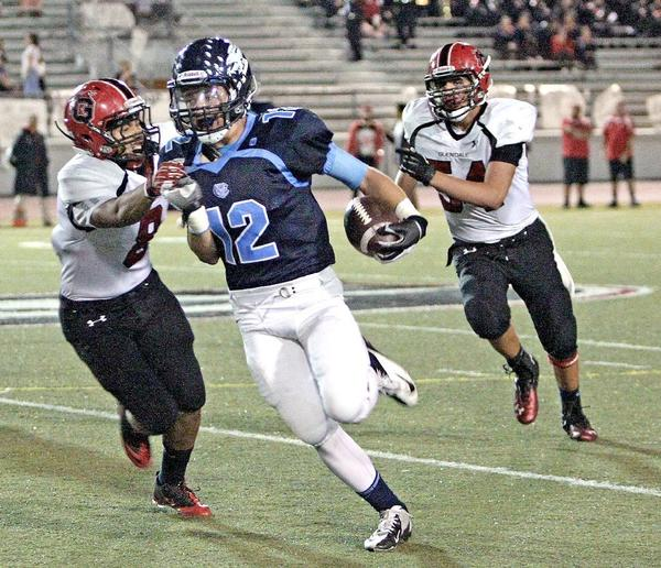 Crescenta Valley safety Tyler Hill picked off one of four pass for the Falcons as Glendale's Osvaldo Cortez and Hratch Yacoubian tried to stop him during Friday's Pacific League's game at Moyse Field. (Roger Wilson/Staff Photographer)