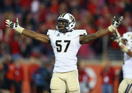 Troy Gray #57 of the Central Florida Knights celebrates after the Knights 38-35 win over the Louisville Cardinals at Papa John's Cardinal Stadium on October 18, 2013 in Louisville, Kentucky.
