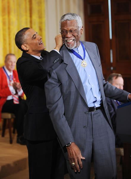 U.S. President Barack Obama honors Boston Celtics star Bill Russell the 2010 Medal of Freedom in a ceremony in the East Room of the White House in 2011.