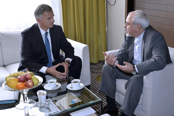 Iranian Foreign Minister Mohammad Javad Zarif, right, speaks with his Swiss counterpart, Didier Burkhalter, on Wednesday during meetings in Geneva on the future of Iran's nuclear program.