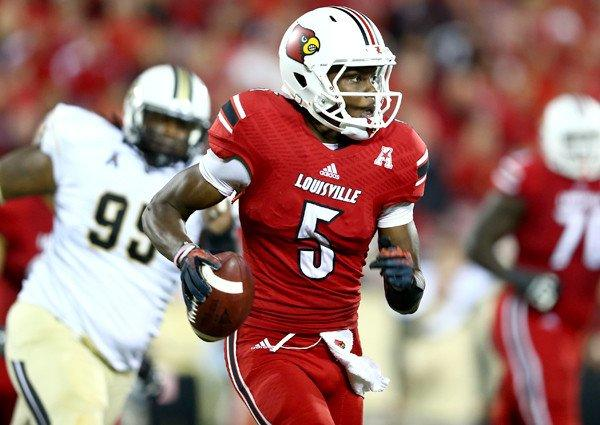 Louisville quarterback Teddy Bridgewater scrambles from Central Florida pressure during their game Friday night.