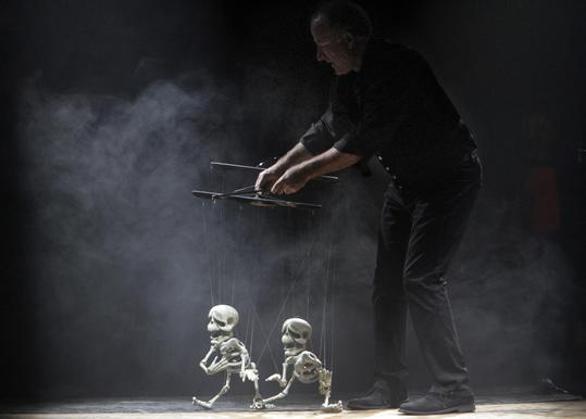A Scott Land Marionettes puppeteer performs in Edward Sharpe and the Magnetic Zeros' Big Top Festival at L.A. State Historic Park.
