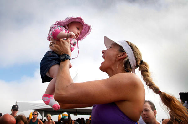 Kerri Walsh Jennings, shown celebrating with son Scout after winning the Manhattan Beach Open in August, is sending an important message for women by going after another Olympic gold medal, beach volleyball veteran Dianne DeNecochea says.