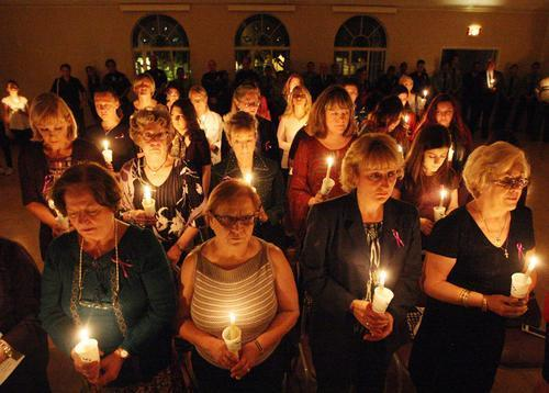 Attendees share a moment of silence during the annual Domestic Violence Candlelight Vigil held at the YWCA.