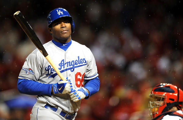 Dodgers right fielder Yasiel Puig reacts after striking out in the eighth inning against the Cardinals in Game 6 on Friday night in St. Louis.