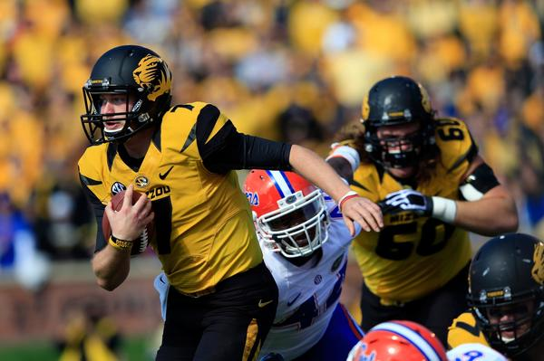 Missouri quarterback Maty Mauk heads into the Florida secondary on a run Saturday.