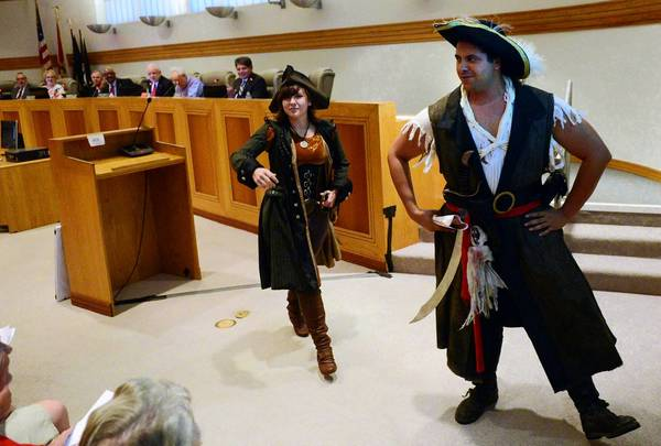 Pirates Danielle Burton and Mike Suarez took over the Boynton Beach Commission meeting Tuesday to read a proclamation to announce the second annual Boynton Beach Pirate Fest and Mermaid Splash October 26 and 27.