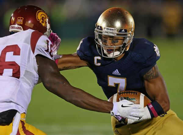 Notre Dame receiver TJ Jones tries to evade USC cornerback Anthony Brown after a reception in the first half Saturday.