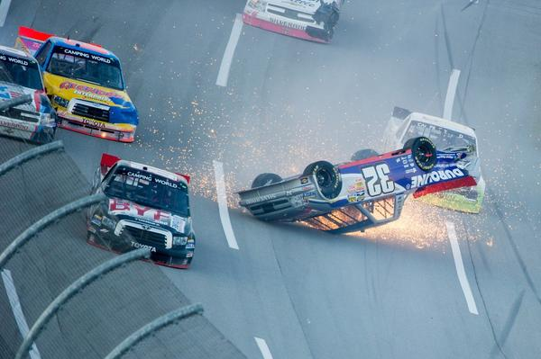 NASCAR Camping World Truck Series driver Miguel Paludo (32) crashes during the Freds 250 at Talladega Superspeedway.
