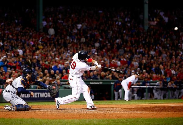 The Red Sox's Shane Victorino hits a grand slam against the Tigers' Jose Veras in the seventh inning of Game 6 of the American League Championship Series at Fenway Park.