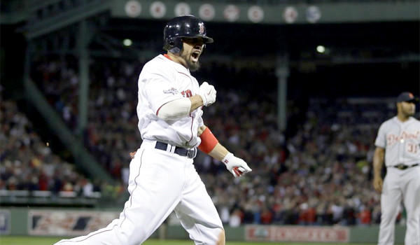 Shane Victorino celebrates his seventh inning grand slam to give Boston a 5-2 lead over Detroit in the Red Sox's American League Championship Series clinching victory over the Tigers on Saturday. Boston will host St. Louis in the in Game 1 of World Series on Wednesday.