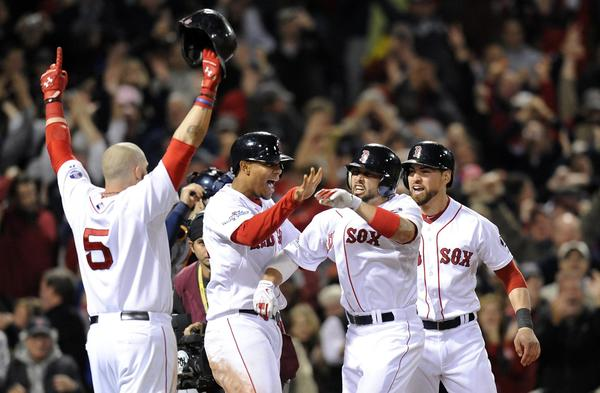 Jonny Gomes, Xander Bogaerts, Shane Victorino and Jacoby Ellsbury celebrate Victorino's grand slam against the Tigers in the seventh inning.