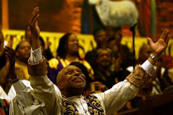 "The Rev. Cecil L. ""Chip"" Murray presides over his last service at First AME church in 2004. Today, Murray's a rare guest at the church he built from 250 members to a congregation of 16,000."