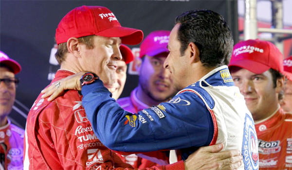 Helio Castroneves, right, congratulates Scott Dixon, left, after his fifth place finish in the MAVTV 500 race at Fontana to claim his third IndyCar title. Castroneves finished second in the standings behind Dixon by 27 points.