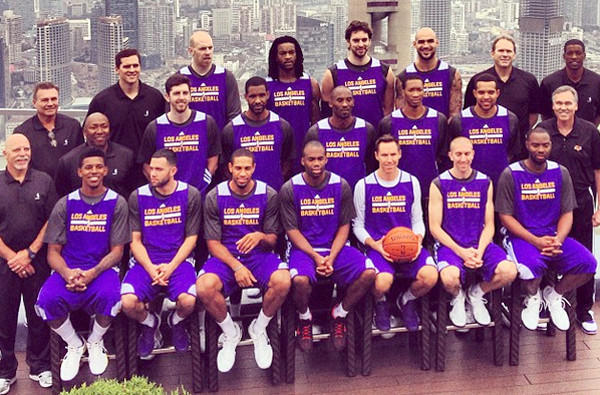 The Lakers take a team picture atop their hotel in Shanghai.