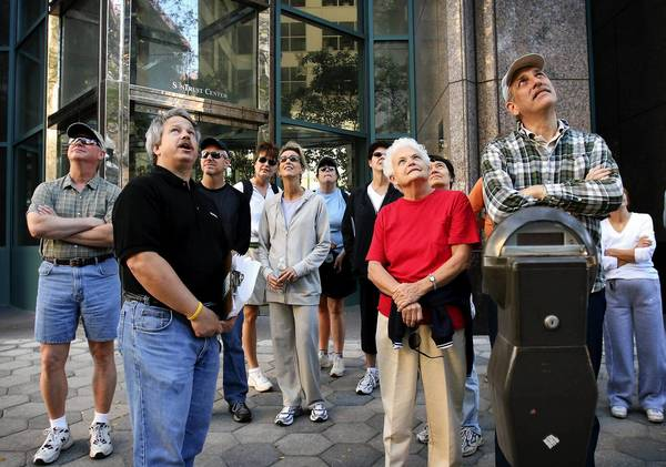 Steve Rajtar (2nd from left, black shirt) explains the history of one of the historical buildings along Church Street during a walking tour of downtown on Sunday morning, January 21, 2007. Rajtar led the group of about 20 people on a free 5.2 mile tour of downtown Orlando.