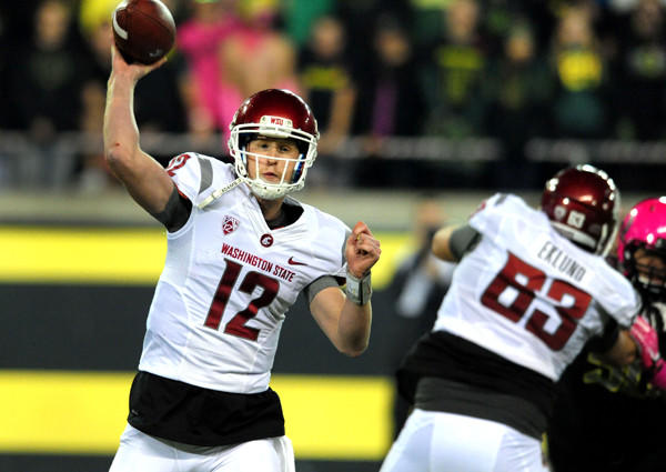 Washington State quarterback Connor Halliday gets off one of his 89 passes against Oregon on Saturday night in Eugene.
