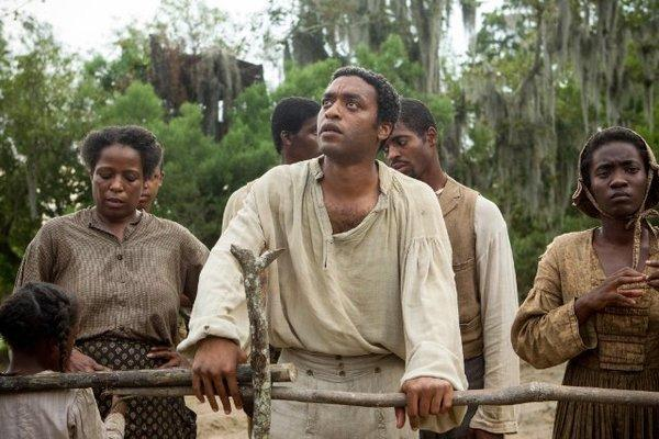 "Chiwetel Ejiofor, center, stars in ""12 Years a Slave,"" which got off to a strong start at the box office this weekend."