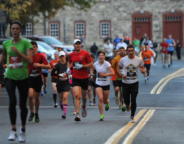 Participants run along North Main Street Street in Bethlehem near the start of the Runner's World Half- on Sunday, October 20, 2013.