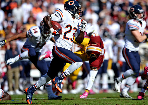Bears receiver Devin Hester returns a punt 81 yards for a touchdown against the Washington Redskins in the second quarter at FedExField on Sunday, extending his NFL record to 13 punt returns for touchdowns.