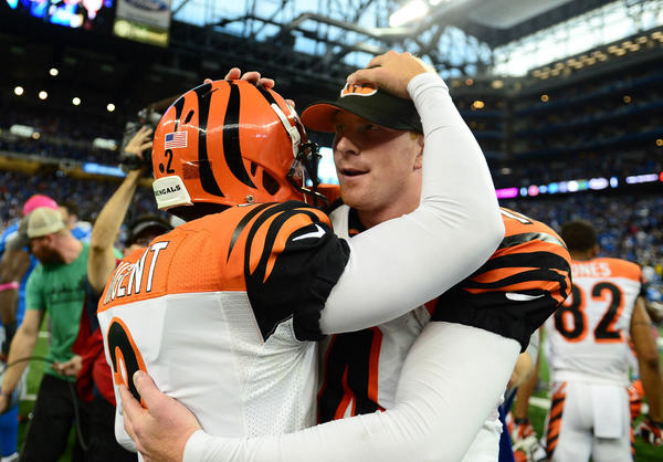 Bengals kicker Mike Nugent (2) celebrates with quarterback Andy Dalton after kicking the game winning field goal to defeat the Detroit Lions 27-24 at Ford Field.