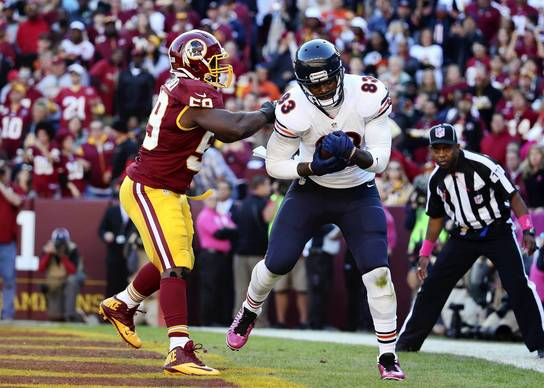 Martellus Bennett catches a touchdown against the Redskins' London Fletcher in the fourth quarter.