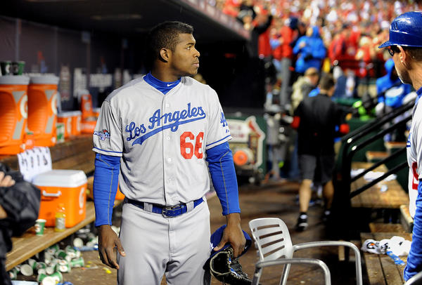 Dodgers rookie Yasiel Puig leaves the dugout after losing to the Cardinals in Game 6 of the NLCS on Friday.