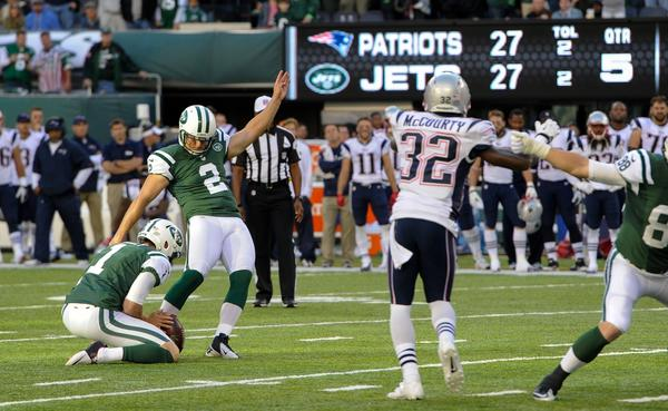 Nick Folk of the Jets hits the winning field goal in overtime against the Patriots at MetLife Stadium on Sunday.