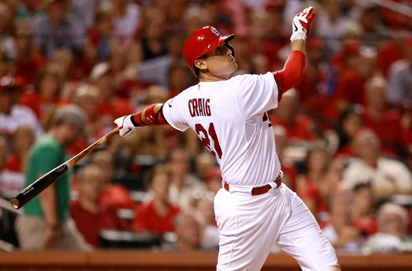 Cardinals first baseman Allen Craig hits a grand slam against the Cincinnati Reds during a regular-season game.
