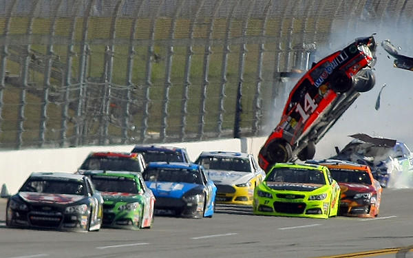 The car of Sprint Cup Series driver Austin Dillon (14) goes airborne with Jamie McMurray (1) in the lead on the last lap Sunday at Talladega Superspeedway.