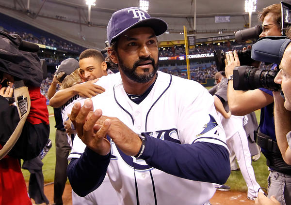 Rays bench coach Dave Martinez celebrates a win.