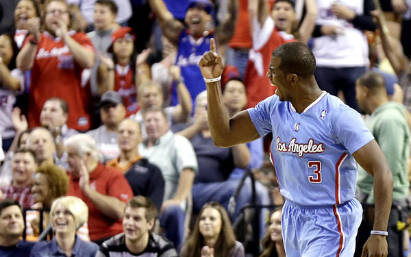 Clippers point guard Chris Paul celebrates a basket to tie the score against the Nuggets in the final seconds of a preseason game Saturday night.