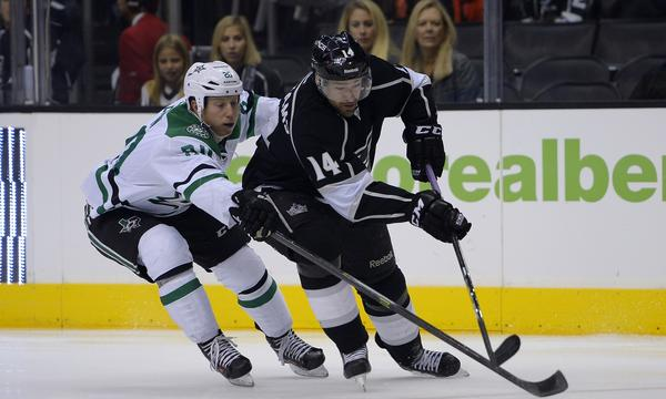 Kings right wing Justin Williams, right, controls the puck in front of Dallas center Cody Eakin during the Kings' win Saturday. The Kings appeared to have put last season's road demons behind them.