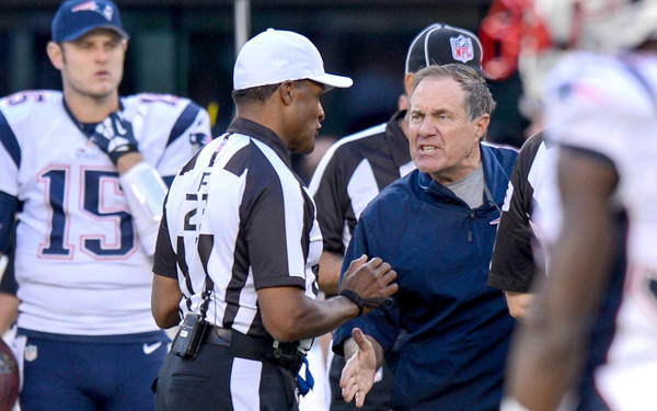 Patrits Coach Bill Belichick argues an unsportsmanlike conduct penalty on a Jets field-goal attempt in overtime Sunday.