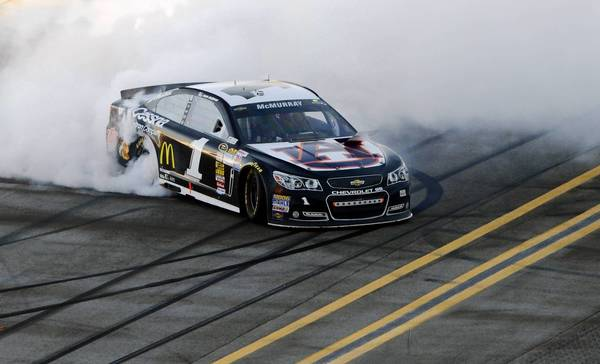 Jamie McMurray does a burnout after winning the Camping World RV Sales 500 at Talladega Superspeedway.