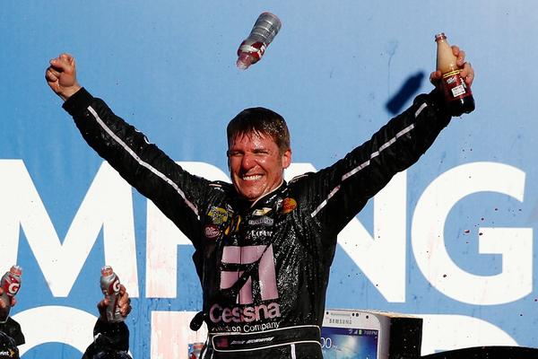 Jamie McMurray celebrates in Victory Lane after winning the NASCAR Sprint Cup Series Camping World RV Sales 500 at Talladega Superspeedway.
