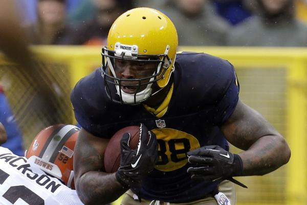 Jermichael Finley of the Green Bay Packers makes the catch and runs in for the touchdown in the first quarter against the Cleveland Browns at Lambeau Field on Sunday.