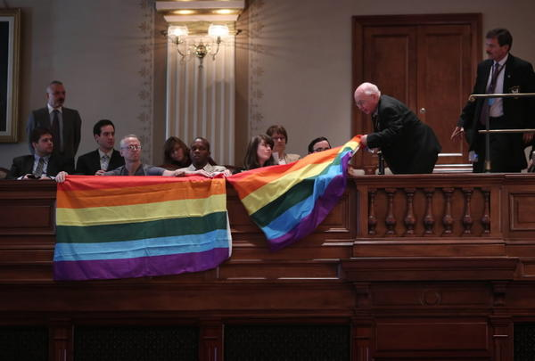 Gay rights activists are ejected from the House chambers at the state capitol in Springfield on May 30, 2013.