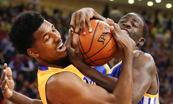 Lakers guard Nick Young battles Golden State's Draymond Green for the ball during a preseason game in Beijing on Tuesday. Young says he had fun visiting China.