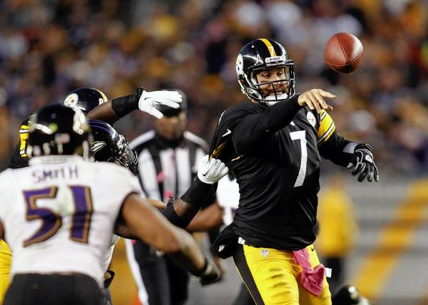 Steelers quarterback Ben Roethlisberger passes the ball under pressure from the Ravens defense during the fourth quarter at Heinz Field. The Steelers won 19-16.