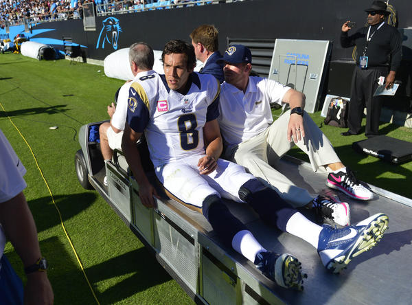 Rams quarterback Sam Bradford is taken from the field on the cart in the fourth quarter.