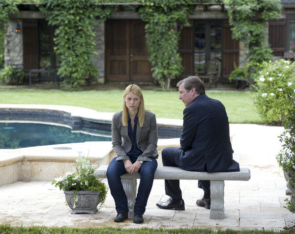 CIA case officer Carrie Mathison (Claire Danes) receives an offer of protection from attorney Leland Bennett (Martin Donovan) on Homeland.