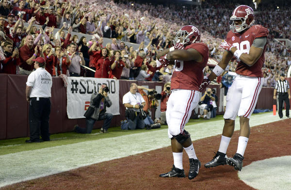Alabama running back Jalston Fowler celebrates his touchdown with tight end O.J. Howard against Arkansas.