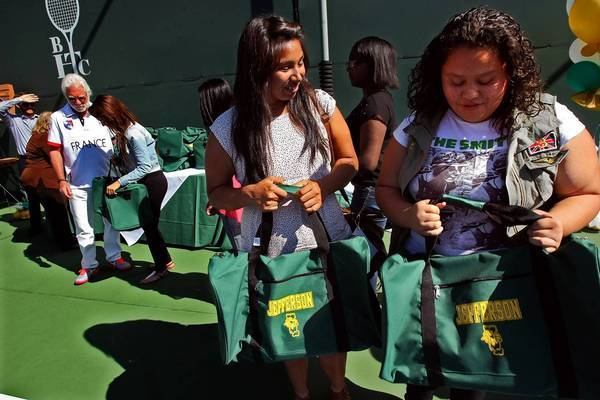 Alma Roque, right, and fellow players marvel at gifts of gear during a Beverly Hills Tennis Club lunch.