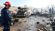 Syria bombing kills dozens as diplomats struggle to set up talks