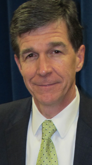 North Carolina Atty. Gen. Roy Cooper is a Democrat in a sea of conservative GOP state officials. He's publicly objected to the state's strict voter ID law, angering Republicans.