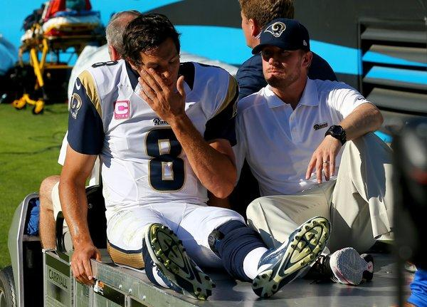 Rams quarterback Sam Bradford is carted off the field after sustaining an injury when he was knocked out of bounds by Mike Mitchell of the Panthers on Sunday afternoon in Charlotte, N.C.