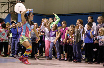 Shlomit Oren leads a group of youngsters at the Boys and Girls Club of Aberdeen Area as they follow along to her dance demonstration Wednesday. Oren and other international students from Northern State University performed as part of a monthly program with the international office at NSU and the club.